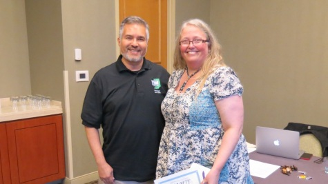 HAMTE President Enrique Galindo thanks outgoing chair of the Nominations and Elections Committee Liz Brown for her service.